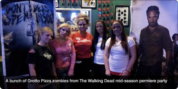 A bunch of Grotto Pizza zombies from The Walking Dead mid-season permiere party